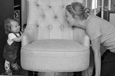Mom Playing Peekaboo with Baby Girl