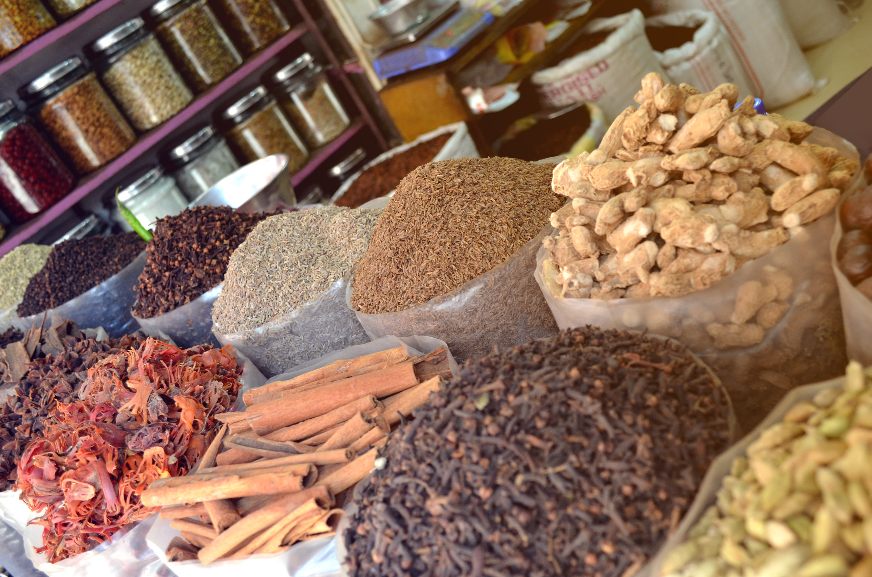 Spices Piled High in Tubs At Market