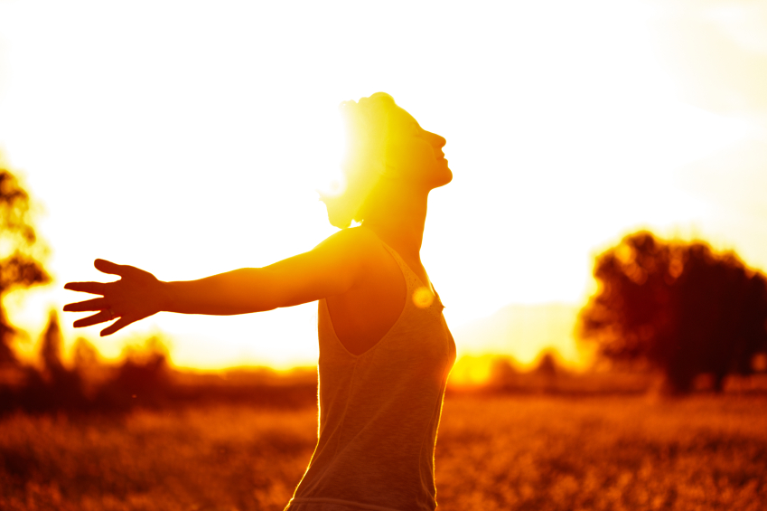 Woman Finishing Jog Staring Into Sun