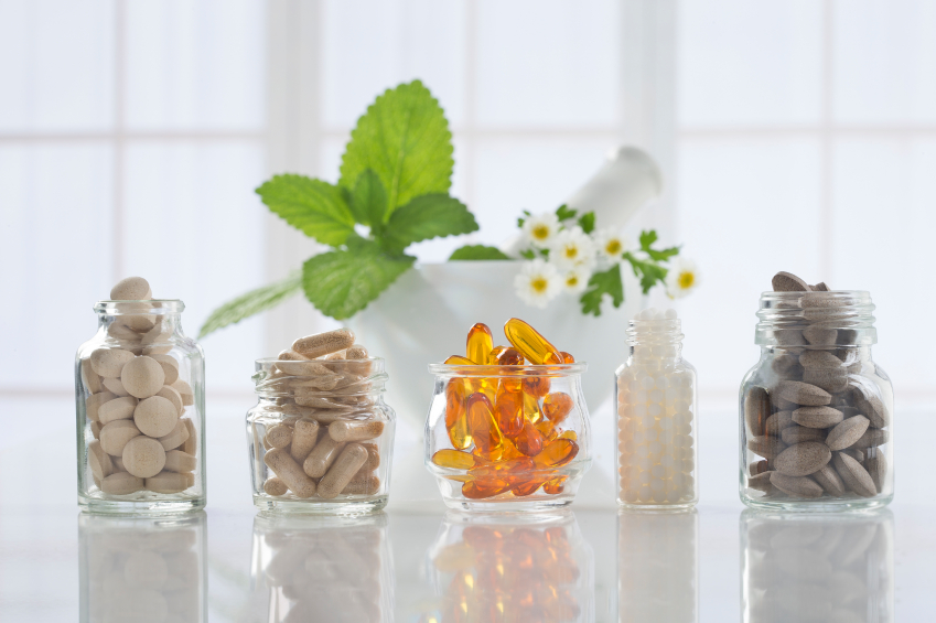 Vitamins in Five Different Glass Bottles