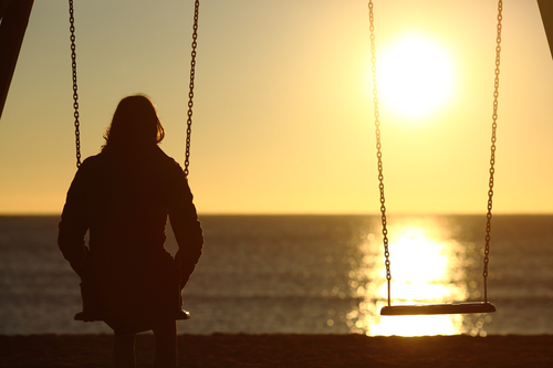 Lonely Woman Watching Winter Sunset