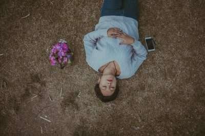 Sleeping Woman on Ground w/ Phone, Flowers