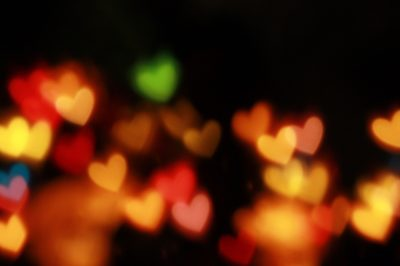 Blurry Multicolored Hearts on Black Background
