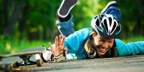 Girl With Helmet Falls Off Skateboard