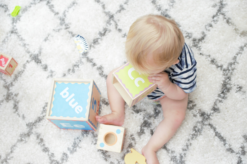 Baby on the Floor Playing w/ Blocks