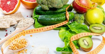 fresh fruits and vegetables, measuring tape to represent healthy weight loss