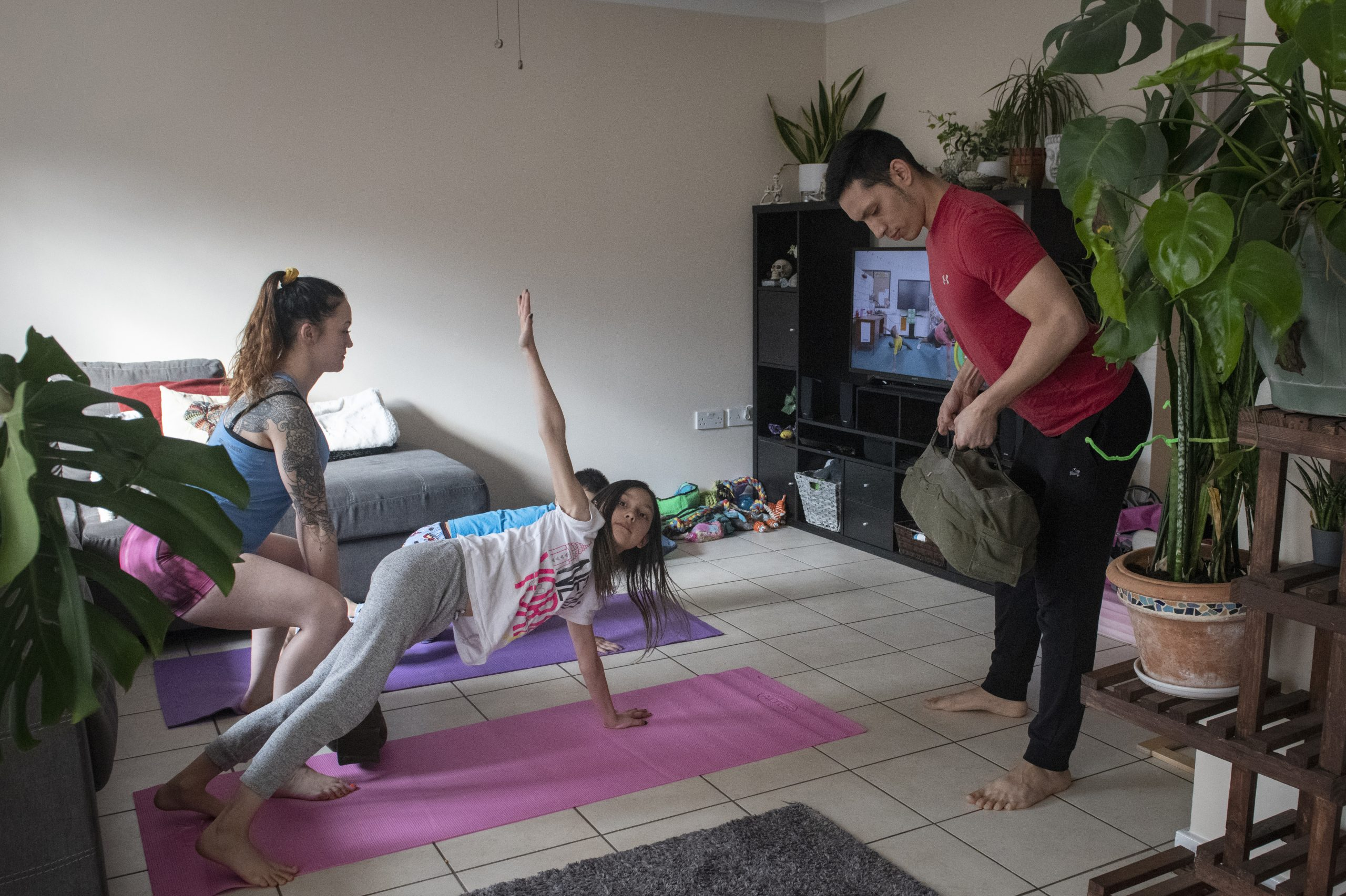 The Nuñez family works out together while being quarantined for two weeks at their home during the COVID-19 outbreak, April 2, 2020
