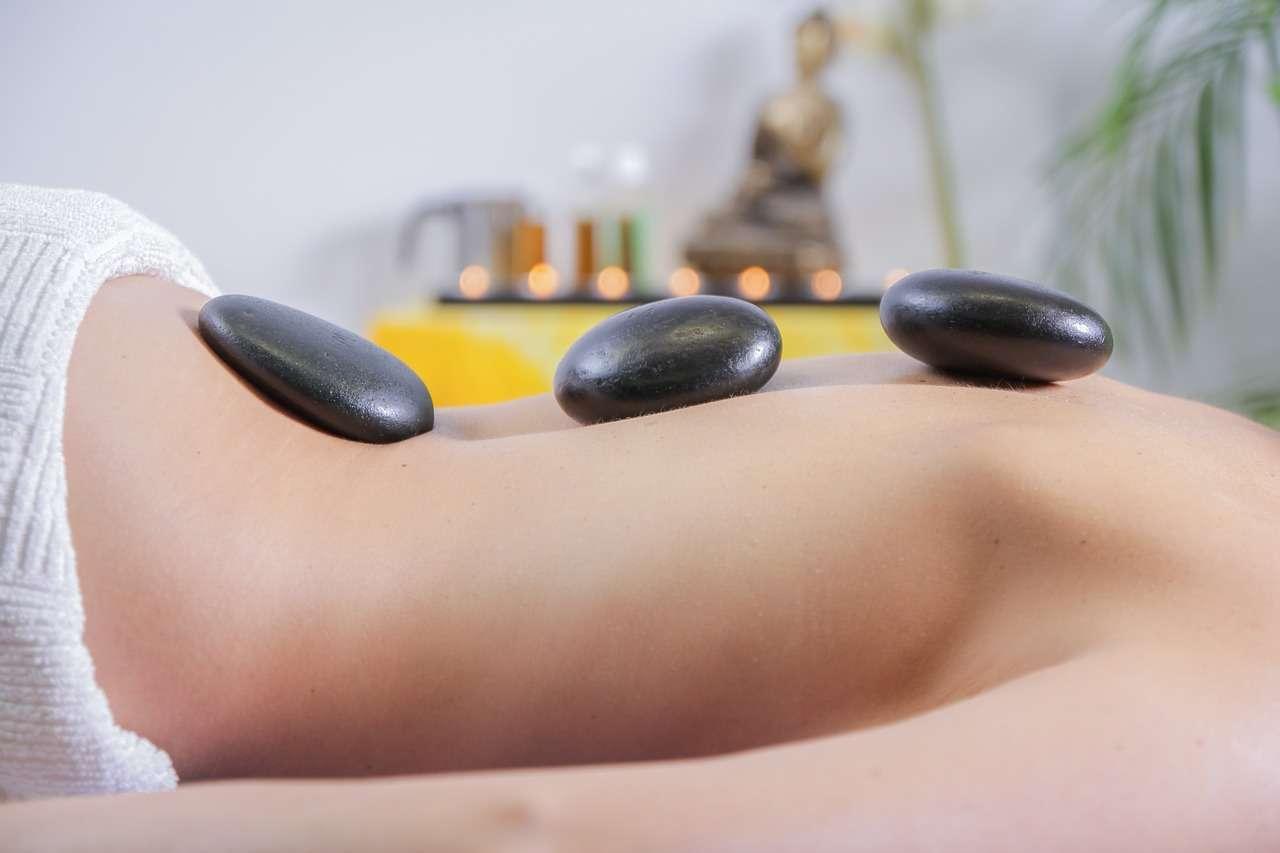 massage stones on back